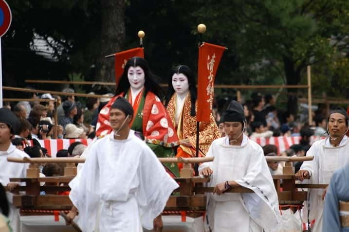 Woman (in gold and red) dressed as Murasaki during the Jidai Matsuri festival.
